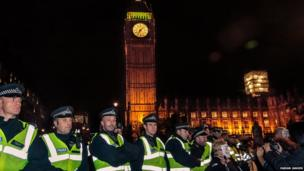 Line of police face demonstrators outside The Houses of Parliament. Photo: Fabian Jansen