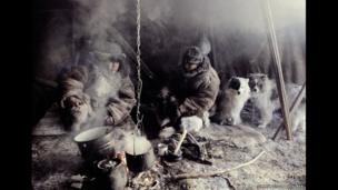 Chukchi from north-eastern Siberia inside a shelter with their dogs