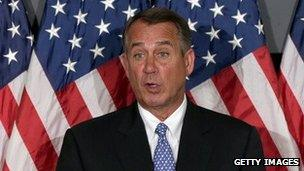 House Speaker John Boehner talks to the media during a House leadership press conference on October 23.