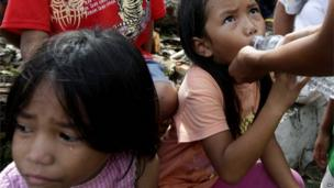 Children wait in Tacloban city, Leyte province in central Philippines