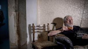 Elguja Kasradze, at home listening to the radio.