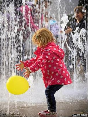 Young girl playing in the fountains at Cabot Circus