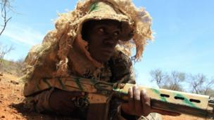 A ranger receives military-style training on Friday at the Madikwe Game Reserve, along South Africa's northern border with Botswana (8 November 2013)