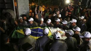 The exhumed remains of Brazil's former president, Joao Goulart, are carried from the Jardim da Paz cemetery in Sao Borja, in Rio Grande do Sul state early on 14 November