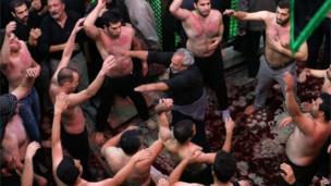 Iranian Shiite Muslims beat their heads and chests during Ashura rituals at Tehran's Karbalaiya Mosque on 14 November