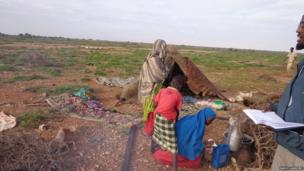 A family in Puntland, Somalia, receiving food aid
