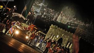 Crowds watch the ceremonial start of the Wales Rally GB in front of Conwy Castle