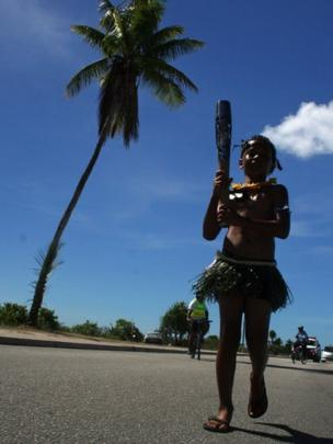 A young boy carries the baton on the small island of Nauru.