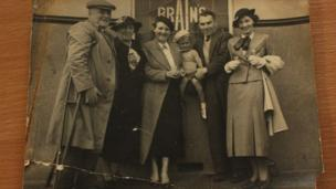 Family in front of Brain's brewery window