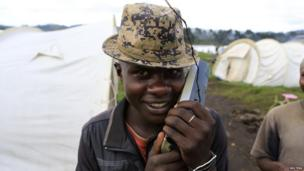 A Congolese refugee listens to a radio at the Nyakabande refugee transit camp in Kisoro district, 491km (305 miles) west of Ugandan capital Kampala - 9 November 2013