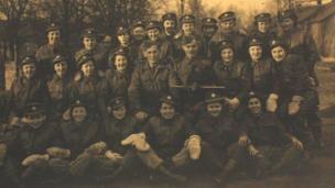 Three ranks of men and women in uniform