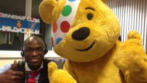 Lawrence G. Badejo-Adegbenga and Pudsey Bear. Photo: HML Ltd