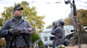 Jason Littleford (left) portrays a German Home Guard at a Military Vehicles Day.
