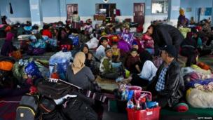 Refugees are seen at temporary evacuation centre following another eruption of Mount Sinabung in Karo district on 14 November 2013 in Medan, Sumatra, Indonesia