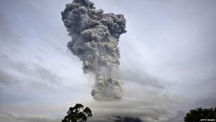 Mount Sinabung spews pyroclastic smoke as seen from Tigapancur village in Karo district on 14 November 2013 in Medan, Sumatra, Indonesia