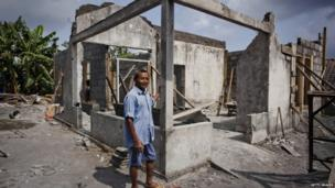 Gianto stands on front of his house destroyed by an eruption of Mount Merapi on 6 September 2013 in Yogyakarta, Indonesia