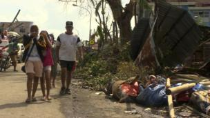 Bodies laying by the roadside in Tacloban, a city devastated by Typhoon Haiyan, in Leyte, central Philippines