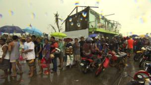 People queuing up at petrol stations in Tacloban, a city devastated by Typhoon Haiyan, in Leyte, central Philippines