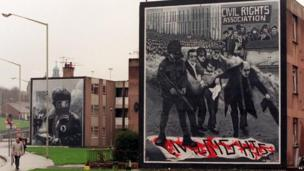 Murals at Free Derry Corner in Londonderry showing scenes from Bloody Friday