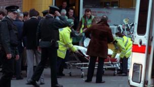 Paramedics treat victims of the shooting