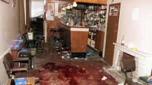 The bloodied floor of the Heights Bar