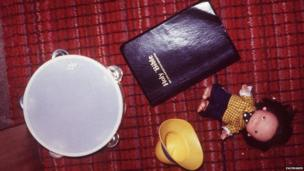 A Bible, a child's toy and other items lying on the ground after the attack