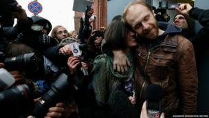 Photographer Denis Sinyakov of Russia embraces his wife Alina