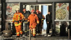Rescuers work at the Maxima grocery store after its roof collapsed in Riga, Latvia, 21 November 2013
