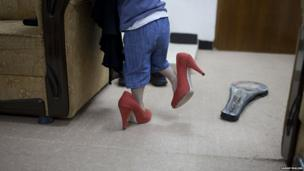 Child wearing woman's shoes