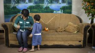 Woman and child at home