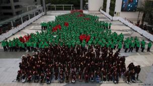 Dressed in red, green and black hoodies, 852 Thai students gather together to break the Guinness World Record for forming the largest human Christmas tree