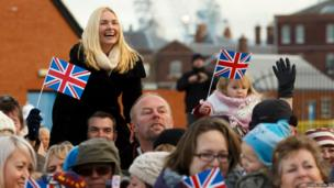 A woman reacts as she catches a glimpse of a loved one onboard HMS Dragon as the destroyer returns to Portsmouth following an eight-month maiden deployment to the Gulf and Mediterranean