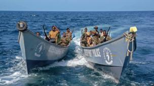 Somali coast guards in boats off Bossasso, Somalia - Tuesday 19 November 2013
