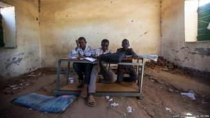 Children sit in a classroom of a school in Labado village, East Darfur