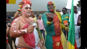 A Tunisian football fan and his Cameroonian rival in Yaounde, Cameron - Sunday 17 November 2013