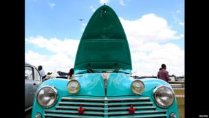 A 1959 Peugeot 203 with its bonnet raised, Nairobi, Kenya - Sunday 17 November 2013