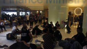 Anti-government protesters rest inside Thailand's Finance Ministry during a rally in central Bangkok 25 November 2013