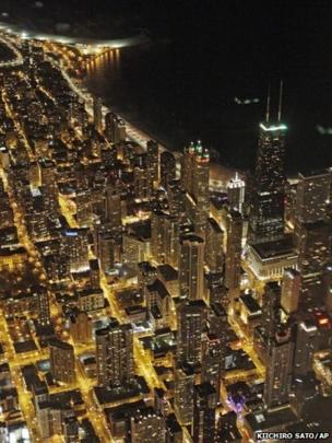 An aerial view at night of the Chicago skyline