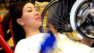 Woman using hand bike