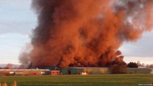 About 60 firefighters are tackling a large blaze at an industrial estate in the Vale of Glamorgan.