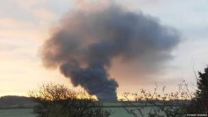 A huge plume of smoke can be seen from miles away