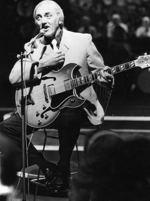 Stan Stennett playing the guitar