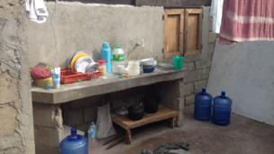 temporary kitchen in makeshift family home