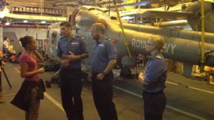 Royal Navy crew talking to Leah onboard ship