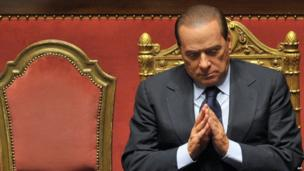 This file picture taken on December 13, 2010 in Rome shows Italian Prime Minister Silvio Berlusconi reacting after he delivered an address to the Senate.