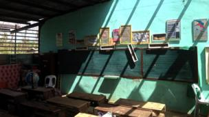 Pupils work in classroom ruined