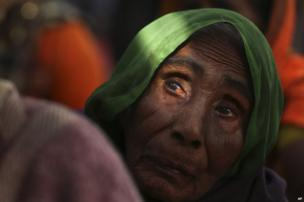 An elderly woman participates in a protest in New Delhi, India, Wednesday, Nov. 27, 2013.