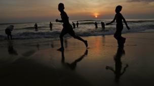 Children running on a beach.