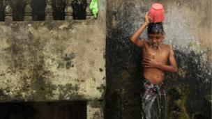 Boy washing.