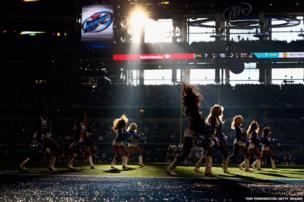 The Dallas Cowboys cheerleaders perform during a Thanksgiving Day game in Arlington, Texas